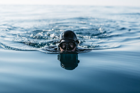 Man practicing free diving in the sea - JRFF01078