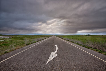 Spain, Province of Zamora, empty road under cloudy sky - DSGF01201