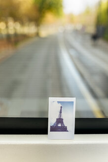 France, Paris, instant picture of the Eiffel Tower on a tourist bus - MGOF02659