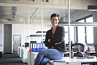 Portrait of smiling businesswoman in office - RBF05244