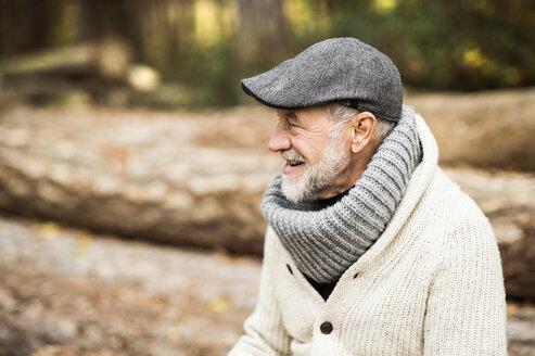 Happy senior man wearing cap and polo neck - HAPF01159