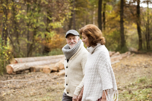 Senior couple walking in the woods in autumn - HAPF01165