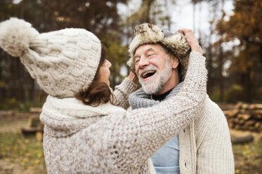 Happy senior couple in autumnal nature - HAPF01171