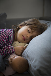 Portrait of little girl sleeping on couch - LVF05648