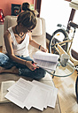 Woman at home working on script - MGOF02661