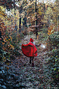 Little imp running in forest in forest, carrying lantern - MJF02105