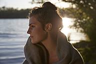 Young woman at a lake at sunset - FMKF03289