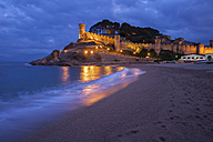 Spain, Costa Brava, Tossa de Mar, main beach and old town wall at night - ABOF00128