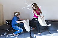 Pillow fight between brother and sister at home - SARF03084