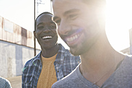 Two happy young men outdoors - WEST22166