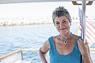 Smiling mature woman on a boat trip - WESTF22211