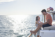 Young couple on a boat trip - WESTF22226