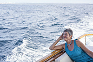 Smiling woman on a boat trip - WESTF22241