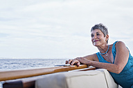Smiling woman on a boat trip - WESTF22244