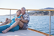 Affectionate couple on a boat trip - WESTF22253