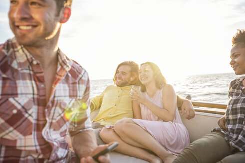 Happy friends hanging out on a boat trip - WESTF22274