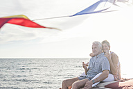 Happy couple having a drink on a boat trip - WESTF22286