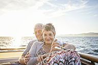 Affectionate couple on a boat trip at sunset - WESTF22292