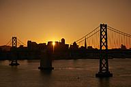 USA, San Francisco, Oakland Bay Bridge at sunset - BCDF00238