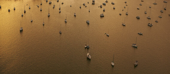View to moored sailing boats at sunset seen from above - BCDF00245