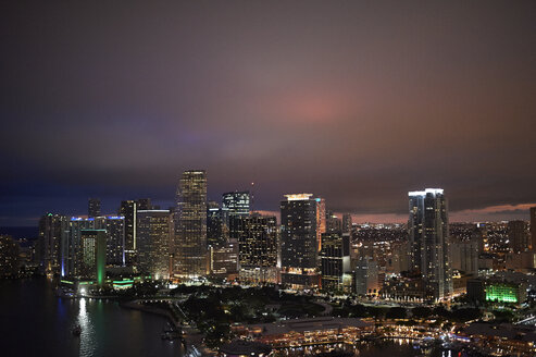 USA, Miami, view the lighted skyline seen from above - BCDF00248