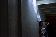 Bridal couple at a wall at night - SIPF01155