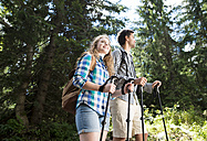 Young couple on a hiking tour in the forest - HAPF01177