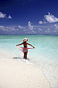 Maldives, woman standing in shallow water - DSGF01241