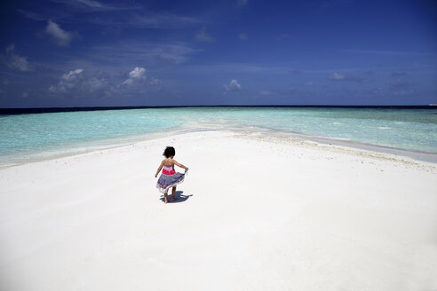 Maldives, girl on beach at shallow water - DSGF01268