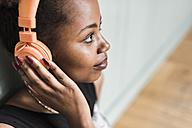 Young woman wearing headphones - UUF09515