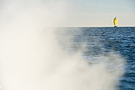 Austria, Bregenz, smoke of motor boat and sailing boat on Lake Constance - SHF01906