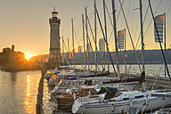 Germany, Lindau, Lake Constance, lighthouse and harbor at sunrise - SH01921