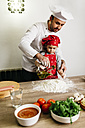 Father and son preparing pizza together - JRFF01097