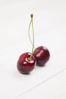 Two sweet cherries on white ground - GWF04921