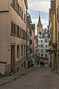 Switzerland, Zurich, view to Pfalzgasse with St Peter's church in the background - KEBF00442