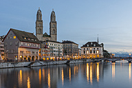 Switzerland, Zurich, view Great Minster with Limmat in the foreground at evening twilight - KEBF00445