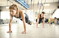 People doing suspension training in gym - JASF01378
