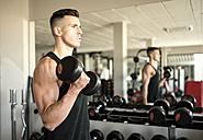 Man training biceps in gym - JASF01390