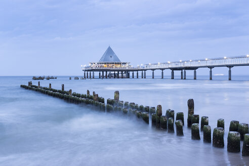Germany, Usedom, Heringsdorf, remains of the old and new pier in the evening - SIEF07222