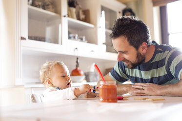 Father and baby at home at dining table - HAPF01209