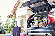 Open car boot packed for family vacation - WEST22295