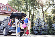 Happy family packing car for vacation - WEST22304