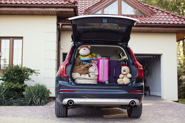 Open car boot packed for family vacation - WEST22319