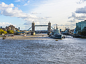 UK, London, view to museum ship HMS Belfast on River Thames with Tower Bridge in the background - AMF05143