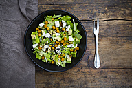 Bowl of leaf salad with roasted chick-peas, avocado, feta and black sesame - LVF05712