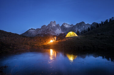 Austria, Salzburg State, Filzmoos, senior man camping in front of Mount Bischofsmutze - HHF05485