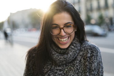 Portrait of happy young woman with glasses outdoors - KKAF00196