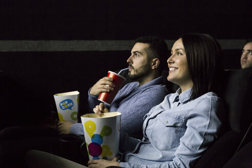 Couple watching a movie in a cinema - ABZF01628