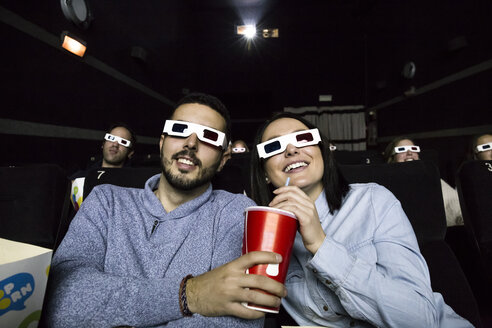 Couple with 3d glasses watching a movie in a cinema - ABZF01634