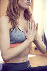 Redheaded woman doing yoga exercise at home - SRYF00180